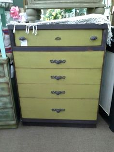 $165 - This is a 5 drawer mid century modern dresser, painted plum and olive. It has metal hardware to add to the look. The chest has been distressed and waxed. It measures 32 inches across the front and 18 inches deep,  standing 43 inches tall. It can be seen in booth D 8 at Main Street Antique Mall 7260 East Main St ( E of Power Rd ) Mesa 85207 480 9241122 open 7 days 10 till 530 Cash or charge 30 day layaway also available