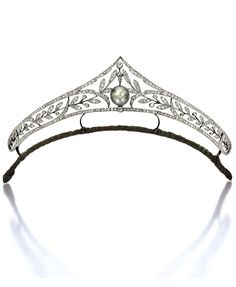 A Belle Epoque Natural Pearl and Diamond Tiara, Circa 1900. The openwork tiara of foliage motif, set with old mine-cut diamonds together weighing approximately 9.00 carats, the centre highlighted by a natural pearl measuring approximately 12.96 x 12.44 x 11.99mm, mounted in silver-topped gold. #BelleÉpoque #tiara