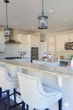 Decked and Styled Spring Home Tour - Kelley Nan- spring kitchen with tufted barstools