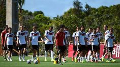 Germany's coach Joachim Loew (C) oversees a training session