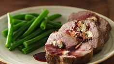 Gorgonzola- and Mushroom-Stuffed Beef Tenderloin with Merlot Sauce. Give classic beef tenderloin an elegant upgrade with creamy gorgonzola, mushrooms and red wine. Grilled Meatloaf, Beef Recipes, Cooking Recipes, Group Recipes, What's Cooking, Copycat Recipes, Yummy Recipes, Yummy Food, Pork