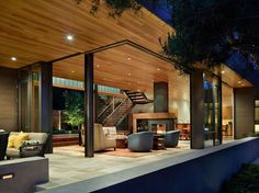 wood ceilings and stone floors that flow inside and out