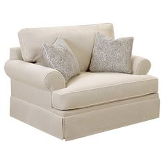 Curl up with a mug of tea and your favorite read on this cozy arm chair, featuring welt-trimmed upholstery and complementing pillows for added comfort. ...