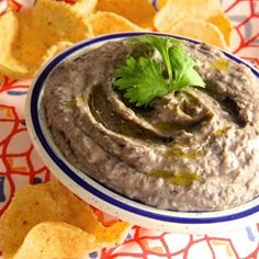"""Quick Black Bean Hummus   """"Black beans make a delicious and healthy alternative to the usual garbanzo beans in hummus. This recipe is a crowd-pleaser and a nice staple at any gathering."""""""