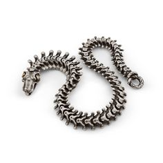 """The unique design of this """"Snake Bones"""" bracelet is modeled on the actual snake vertebrae and is exceptionally detailed. Designed and handcrafted by Anatoly Startsev in sterling silver, 18KT gold with diamonds."""
