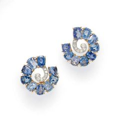 A PAIR OF SAPPHIRE AND DIAMOND EAR CLIPS, BY BOUCHERON   Each designed as a cushion-cut sapphire scroll, with collet-set diamond accents, terminating with old European-cut diamond scrolled detail, mounted in 18k gold and platinum, with French assay marks  Signed Boucheron, Paris