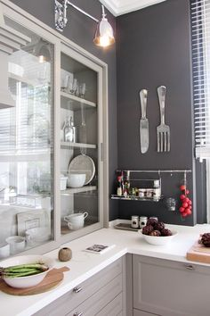 Fabulous kitchen with light gray cabinets paired with polished nickel hardware and sleek white countertops. Grey Kitchen Walls, Grey Kitchen Cabinets, Gray Walls, Grey Cupboards, Kitchen Cupboard, Kitchen Sink, Kitchen Storage, New Kitchen, Kitchen Decor
