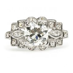 Melbourne is a vintage Art Deco engagement ring featuring a 1.37ct Old European cut diamond in a crisp geometric platinum setting. Amazing! TrumpetandHorn.com | $13,500