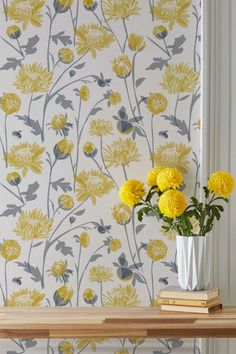 Lovely wallpaper pattern featuring stylised yellow and silver chrysanthemum flowers with little bumble bees!