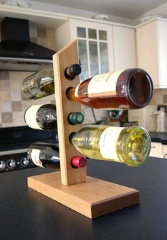 Solid oak cantilever wine rack crafted in the UK by MijMoj.