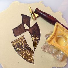 """""""S"""" done with walnut ink and Automatic Pen. Flourishes added with Holbein Pearl Gold Gouache and pointed pen."""