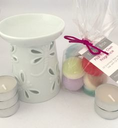 Our Scented Soya Wax Melt Starter Kit, including a pretty dragonfly oil burner, 10 hand-poured scented soya wax melts of your choice and 5 tealights to get you started. This makes the perfect gift or a special treat to fragrance your home.    Hand-poured using 100% natural soya wax, presented in a clear block bottom cellophane bag and finished with a silk cord bow. Our soya wax melts have been created using quality high grade oils and we use a high concentration of fragrance to make sure…