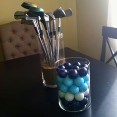A cute way to incorporate golf into cabin decor! I used my husbands old clubs that he got from his grandpa so they are special to look at.  I spray painted old golf balls to match the cabin's colors.