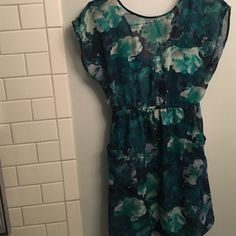 Teal flowy dress  Cute teal print flowy dress - tank layer underneath , pockets and a little v back - worn once! Size medium Xhilaration Dresses Mini