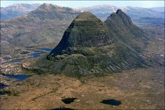 """This aerial view shows the Suilven and Canisp inselbergs, or """"island mountains"""", in the west of Sutherland, Scotland, which were shaped by . Scotish Highlands, England, Scotland Travel, Mountain Landscape, British Isles, Nature Pictures, Aerial View, Places To See, Landscape Photography"""
