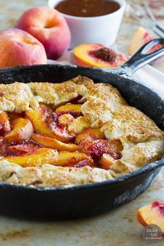 Sweet summer peaches fill this rustic pie baked in a cast iron skillet. This Cast Iron Peach Crostata Recipe will be on repeat during peach season!: