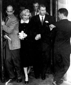 Marilyn Monroe marries Joe DiMaggio, 1954...For her wedding to baseball player Joe DiMaggio,  Marilyn chose an unconventional brown suit with a white mink-collar