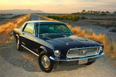 ford mustang 1967...the one I bought Gary for our first Anniversary is blue  (The key to being a great wife...LOL)