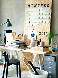 Perpetual Wall Calender - I'd jazz it up a bit more than stenciled plywood, but I love this idea.