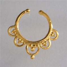 Unique Gold Plated Septum For Non Pierced Nose - Septum Jewelry - Indian Nose Ring - Ethnic Septum - Septum Piercing - Nose Jewelry New and beautifully made brass gold plated septum for a non pierced nose. Bar size: 1mm. 18 gauge Inner ring :10mm. Total diameter: 11mm. Width: 14mm. Available in silver ,brass and gold plated for pierces and non pierced nose. $19