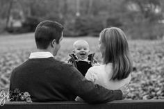 Playing a game of peek a boo during a family photo session in a Raleigh park before the Holidays.