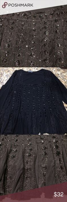 Black sequin chiffon flutter top. Black chiffon flutter style top. Has flower sequins and flower crochet on it. It is pleated/fluttery at the bottom. A lightweight chiffon material. Worn only one time. The Pyramid Collection Tops