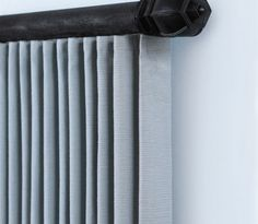 ripplefold drape.  operable panels on a wooden rod.  Gallery | Kirsch.com