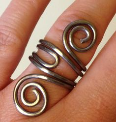 Spiral Ring Long Ring Aluminum Wire Wrapped Ring Hammered Metal Ring Pewter Wire Wrap Ring Artisan Handcrafted Handmade Adjustable ITEM0327. $11.95, via Etsy.