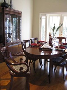 Tropical British Colonial Style (Add different chairs to mahogany dining room set to create this look? Hmmm.)