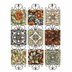 """Three piece ceramic and metal wall decor set with a scrolling floral motif.  Product: 3 Piece wall decor setConstruction Material: Metal and ceramicColor: MultiFeatures:  Rich floral design Dimensions: 44"""" H x 10"""" W x 1"""" D each"""