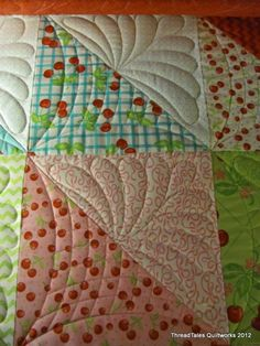 Great machine quilting idea for half square triangles.It just dawned on me...I can hoop my quilt after piecing..square by square and do this on my embroidery machine!!! I knew that, but somehow forgot!!!!