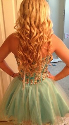 Pretty hair, and pretty dress. Perfect for homecoming.