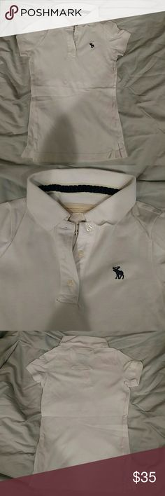 Abercrombie and Fitch White Polo Abercrombie and Fitch white polo T-shirt NWOT Reasonable offers accepted ;) Willing to drop price at agreed upon time to give the hour of discounted shipping! Abercrombie & Fitch Tops Tees - Short Sleeve