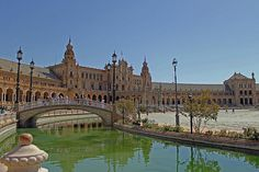 The Plaza de Espana, designed by Anibal Gonzalez, was a principal building built on the Maria Luisa Parks edge to showcase Spain's industry and technology exhibits during the Ibero-American Exposition in 1929.