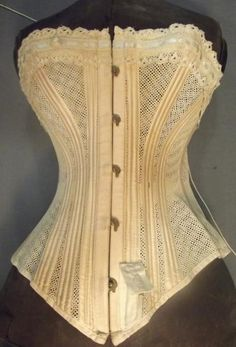 "Tulle Corset 1875.  Well ventilated.  I would call this ""net"" rather than ""tulle"".  Perhaps ""mesh""."