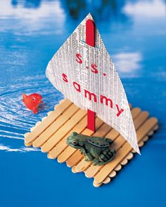 Popsicle stick sailboat- paint them blue first for little blue boat