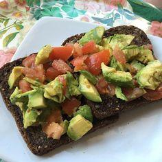 Avo toast with chopped tomatoes & chill  garlic flakes  #bestofavocado by bestofavocado