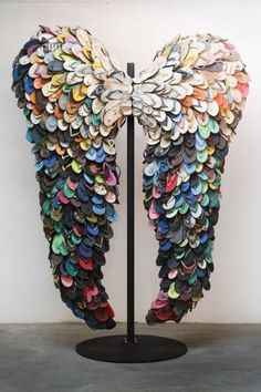 Last Flight by Alfredo and Isabel Aquilizan, wings sculpture made of used flip flops