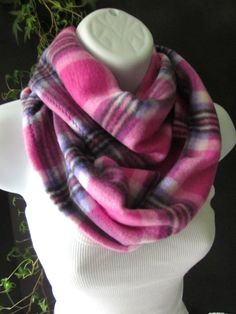 Add some life to that dark, winter coat! These scarves are great gifts for everyone on your list! The plaid in this fleece infinity scarf is a pretty blend of pale pink to fuchsia to purple with black and white accents. This fleece fabric is really nice! It is super soft, cozy and