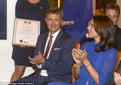 In love: Throughout the evening Prince Frederik was snapped shooting his wife a number of ...