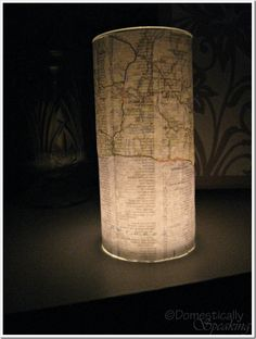 Decoupage Map Candle.  {Could also use Christmas lights inside.}