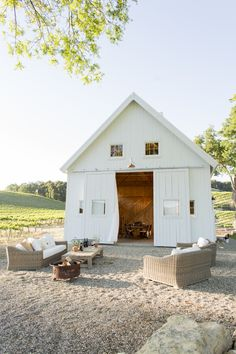 Wine country, white barn with loft area, vineyard, outdoor sitting area. I love the rolling barn doors that bring the outdoor and indoor living spaces together. Outdoor Rooms, Outdoor Living, Outdoor Seating, Indoor Outdoor, Outdoor Lounge, Barn Wedding Decorations, Wedding Ideas, Wedding Reception, Reception Ideas