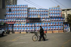 A two-storey building in downtown Shanghai has narrowly avoided demolition after it was covered in posters of President Xi Jinping.