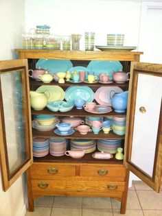 Rustic cabinet filled with LuRay Pastels - dishes from the 1930s and 1940s