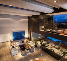 Playing up the city views, this Mexico residence was designed to benefit from its location where the front of the house opens up to enjoy those views.