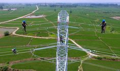 July 17, 2017:  Workers check power lines during maintenance work in Laian, in China's eastern Anhui province.