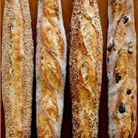 A sourdough baguette as perfect that a baguette can be with its crisp outer crust, flavoursome taste of high-quality wheat used and an inner texture that's light and airy but full of substance. Comes with a high recommendation! Kalamata Olives, Sourdough Bread, Artisan Bread, Baguette, Banana Bread, Crisp, Bakery, Desserts, Product Review