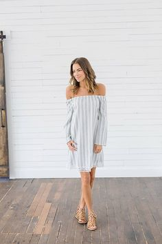 Our Out to Sea Striped Tunic Dress is a must-have for your summer wardrobe! Its fun and flirty off the shoulder design will have you turning heads