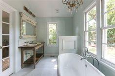 Farmhouse Bathroom With Chandelier Over Tub.