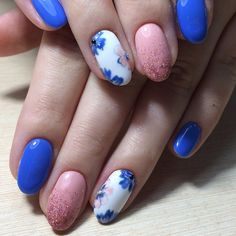 Blue and Pink Floral, glittery nail art design. You might have always seen blue paired up with gold, white or simple black. And if you want something different, then pair it up with pink glittered one and thank me later.